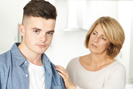 Photo for Mother Worried About Unhappy Teenage Son - Royalty Free Image