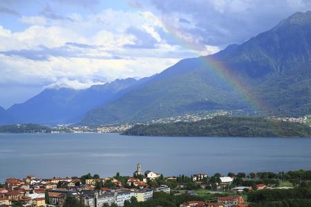 Foto de Look over Gravedona to Colico at Lake Como with a colored rainbow in the sunshine - Imagen libre de derechos