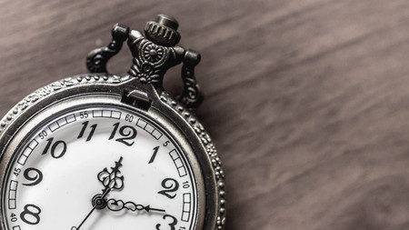 Photo for old vintage pocket watch showing time with wooden background. time and priority concept - Royalty Free Image