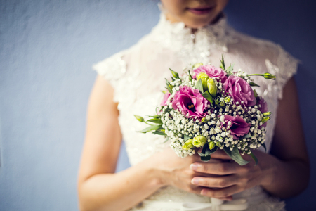 Woman holding colorful bouquet with her hands in wedding day