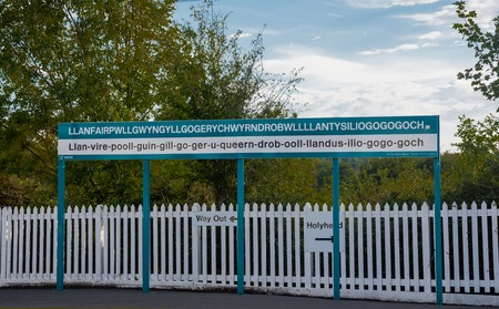 Photo for The longest place name of the UK, Llanfairpwllgwyngyll, on a sign - Royalty Free Image