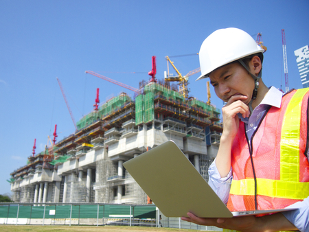 Photo for Construction worker using laptop - Royalty Free Image
