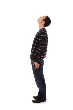 young man standing with his head looking up (isolated on white)