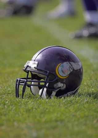 Football helmet placed on the playing field.