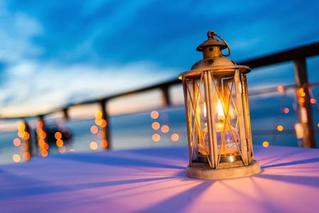 Photo pour Lantern on table at twilight sky, selective focus. - image libre de droit