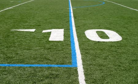 Green football field with large yard numbers. mural
