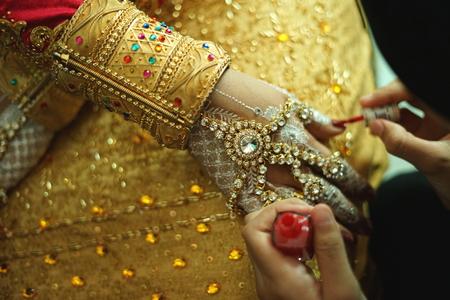 Photo for Wedding Ritual, woman hand applying a henna tattoo - Royalty Free Image