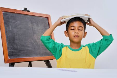 Photo for Bored boy too lazy doing his homework, Education concept - Royalty Free Image