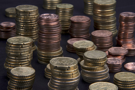 a lot of different high stacked heaps of Euro-Cent coins