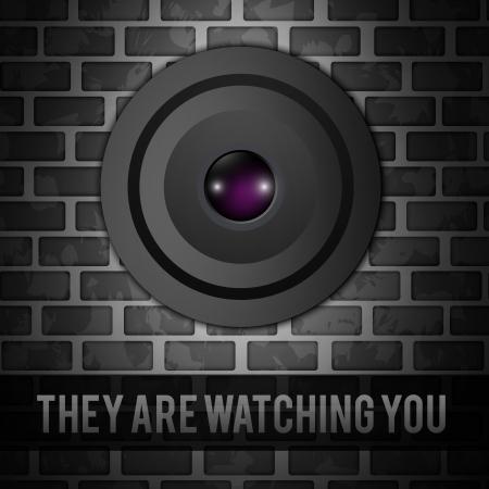 Webcam on gray bricks wall