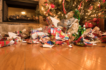 Foto de Mess of wrapping paper after all the gifts have been opened. - Imagen libre de derechos