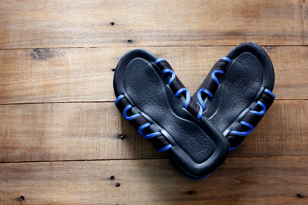Photo for Slippers on Wooden Background - Royalty Free Image