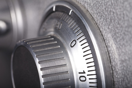 Foto de combination lock on the safe closeup gray - Imagen libre de derechos