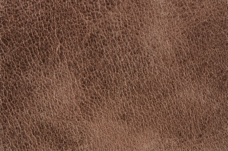 Brown leather texture closeup detailed background.