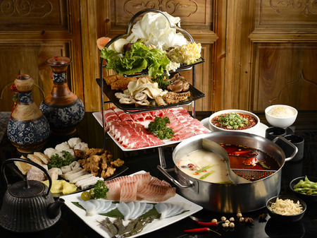 Photo for Double favor hot pot soup with wide variety of ingredients - Royalty Free Image