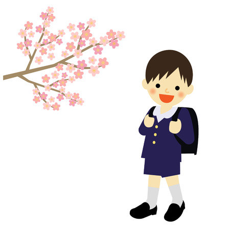 School boy with blooming cherry blossoms