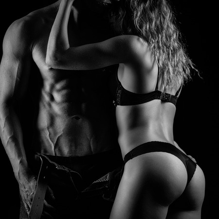 Foto de Artistic photo of fitness couple hugging. Black and white - Imagen libre de derechos