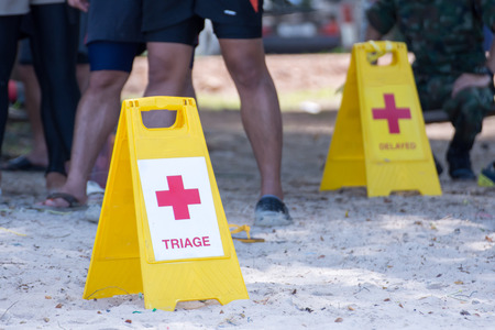 Foto de Yellow label indicates the separation of patients in disaster water - Imagen libre de derechos