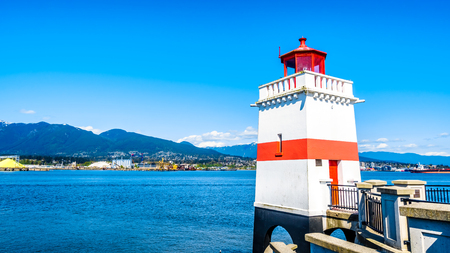 Foto per The Lighthouse at Brockton Point on the famous Seawall pathway in Vancouver's Stanley Park - Immagine Royalty Free