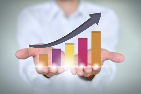 Foto de A businessman holding economic growth chart - Imagen libre de derechos