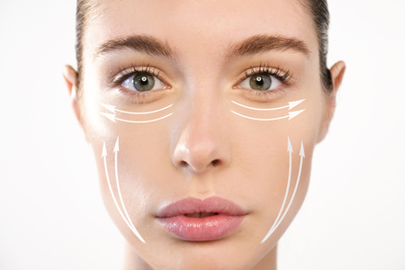 Foto per Close up portrait of a beautiful woman with anti wrinkle creams or surgery. Concept of: surgery, creams. - Immagine Royalty Free