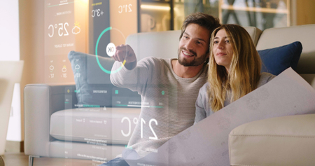 Photo pour A couple sitting on the sofa controls all the functions of the house such as wi-fi, heating, lighting, and television through holography. Concept of, home automation, automations, future, technology. - image libre de droit