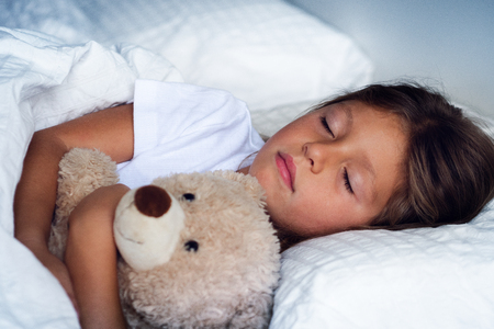Photo pour A beautiful girl sleeps and has her dreams. The girl smiles because she is relaxed and sleeps well. Concept of: relax, love sleep. - image libre de droit