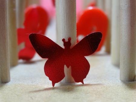 Foto de Art diferent colored objects red butterfly - Imagen libre de derechos