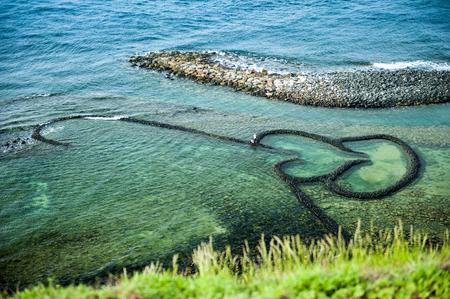 Photo for Twin Heart Stone Weir(Chimei,Penghu,Taiwan) - Royalty Free Image