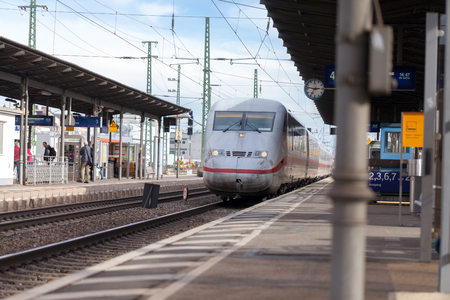 Foto per FUERTH / GERMANY - MARCH 11, 2018: ICE 2, intercity-Express train from Deutsche Bahn passes train station fuerth in germany. - Immagine Royalty Free