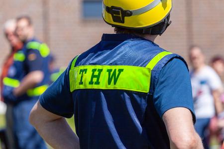 Foto de Delmenhorst / Germany - May 6, 2018: German technical emergency service sign on a vest from a man. THW, Technisches Hilfswerk means technical emergency service. - Imagen libre de derechos