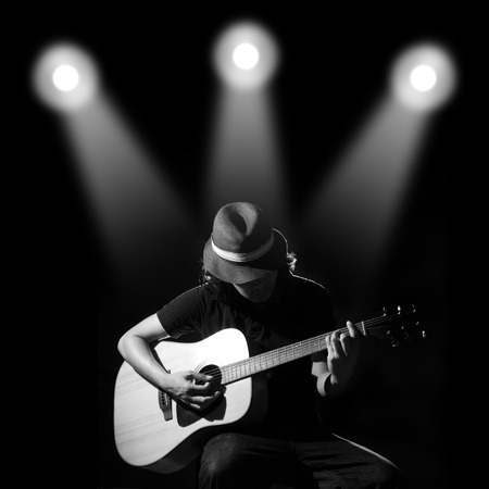 Photo for Man playing guitar. Black and white photo - Royalty Free Image