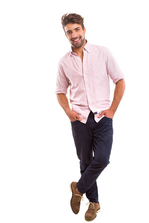 Foto de Studio picture of a young and handsome man posing isolated - Imagen libre de derechos