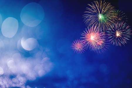 Photo pour colorful fireworks at right corner with blue bokeh background - image libre de droit
