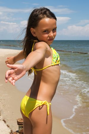 Small girl posing at the beach alone