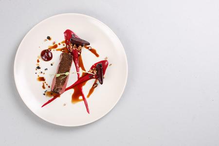 Foto de Delicious veal fillet served with sauce, molecular froth and beetroot - Imagen libre de derechos