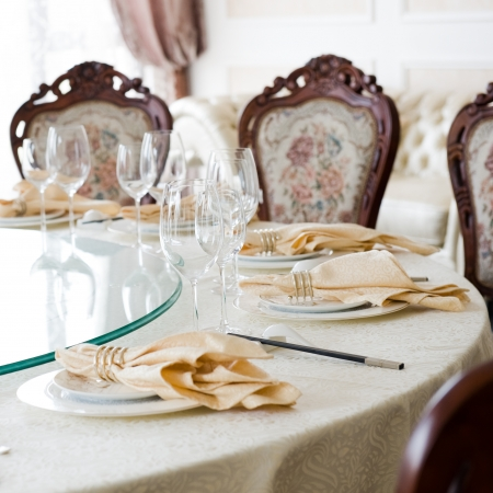 Formal dining room table and chairs set for dinner