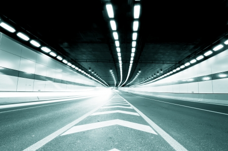Abstract speed motion in urban highway road tunnel, blurred motion toward the central  Shot from a slow moving car