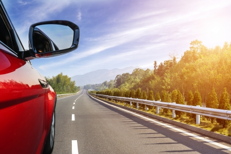 Foto per car on the road with motion blur background. - Immagine Royalty Free