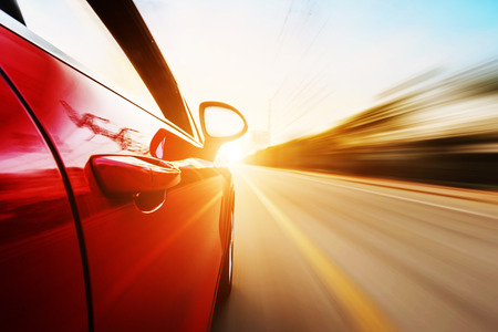 Photo for A car driving on a motorway at high speeds, overtaking other cars - Royalty Free Image