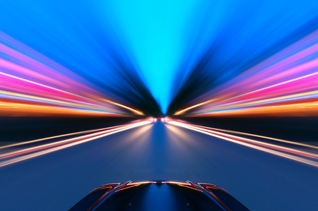 Foto per A car driving on a motorway at high speeds, overtaking other cars - Immagine Royalty Free