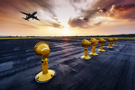 Foto de Runway, airstrip in the airport terminal with marking on blue sky with clouds background. Travel aviation concept. - Imagen libre de derechos