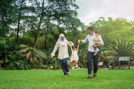 Foto de malay family having quality time in a park with morning mood - Imagen libre de derechos
