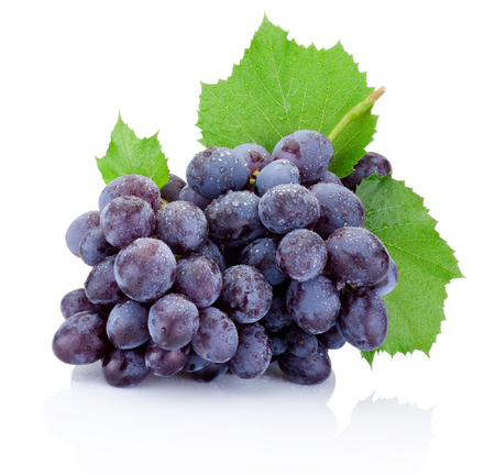 Foto de Fresh bunch of grapes with leaves isolated on a white background - Imagen libre de derechos