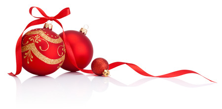 Foto de Red christmas decoration baubles with ribbon bow isolated on white background - Imagen libre de derechos