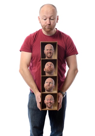 Man choosing Many faces concept symbolizing different emotions or multiple personalities.