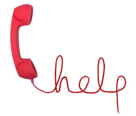 Photo pour Red telephone with help text  isolated on a white background - image libre de droit