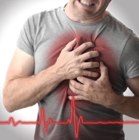 Foto de Man grabbing chest in pain - Imagen libre de derechos