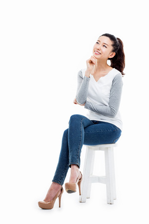 Photo pour Thinking young Asian woman isolated on white background - image libre de droit