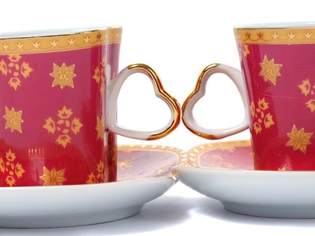 Heart coffee cup over white